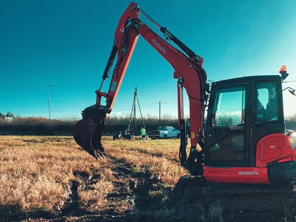 A digger in a field about to break into the soil